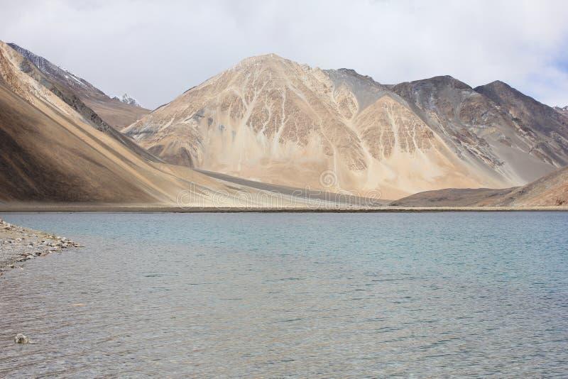 Pan gong lake in Himalayas at 4350 meters, India. High grassland lake, with mountains stock image