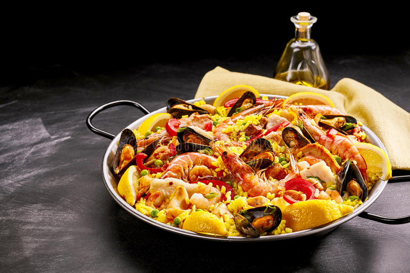 Pan of gourmet paella with shrimp and mussels stock images