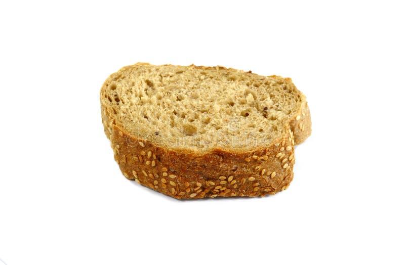 Pan, harina y trigo en una tabla de madera Diversos tipos de pan, de harina y de trigo en una tabla de madera fotos de archivo