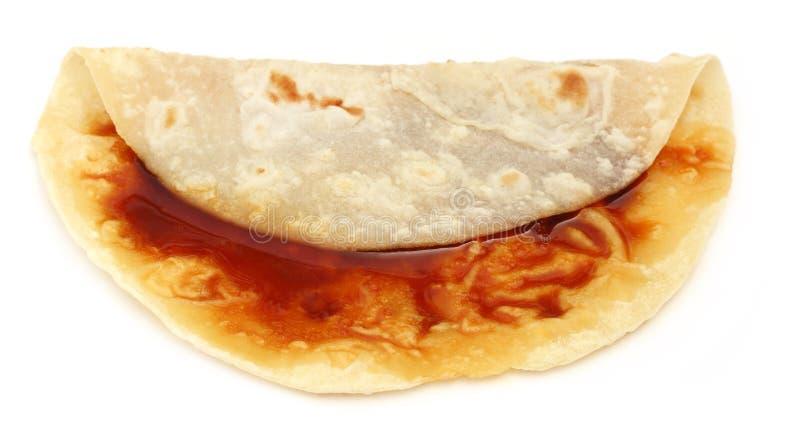 Pan hecho a mano del roti con melaza imagen de archivo libre de regalías