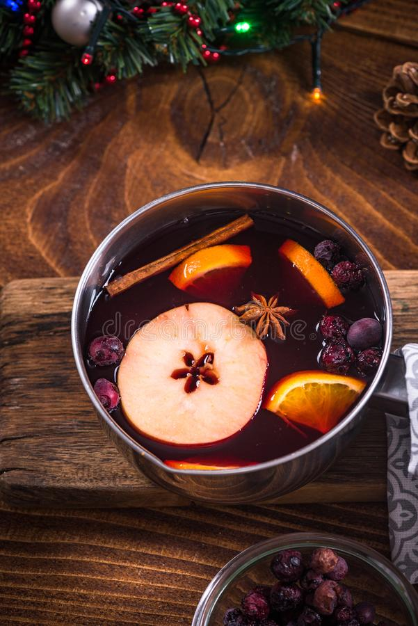 Pan with hot mulled wine, Christmas festive drinks stock images