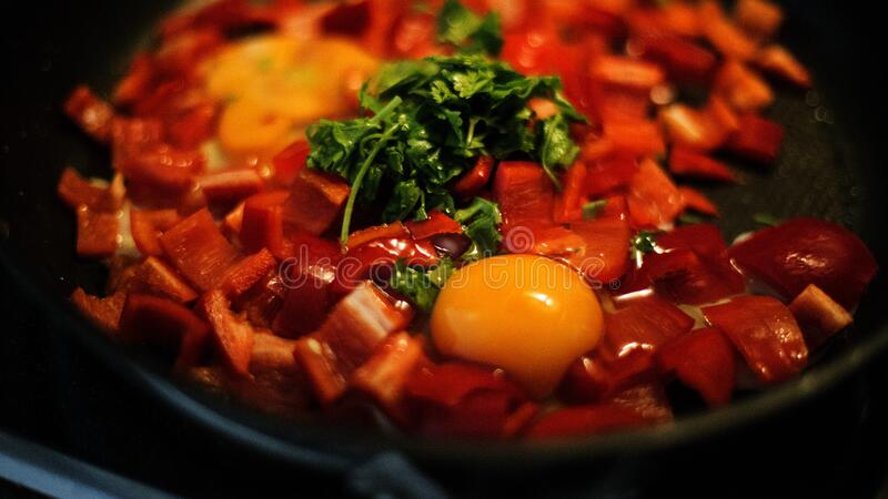 Pan of peppers with egg stock image