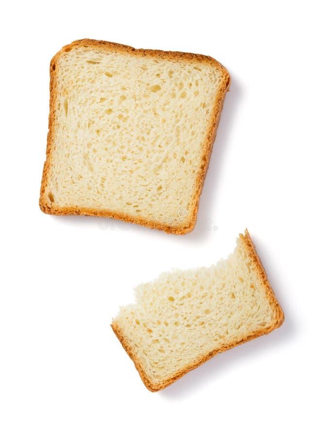Pan rebanado aislado en blanco fotografía de archivo