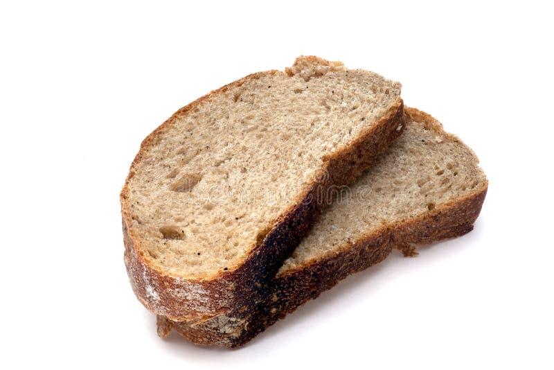 Pan rebanado en el fondo blanco foto de archivo