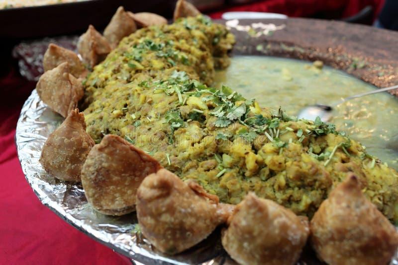 Pan with samosa potato and pea curry royalty free stock image