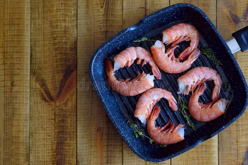 Delicious shrimp in the pan. royalty free stock photography
