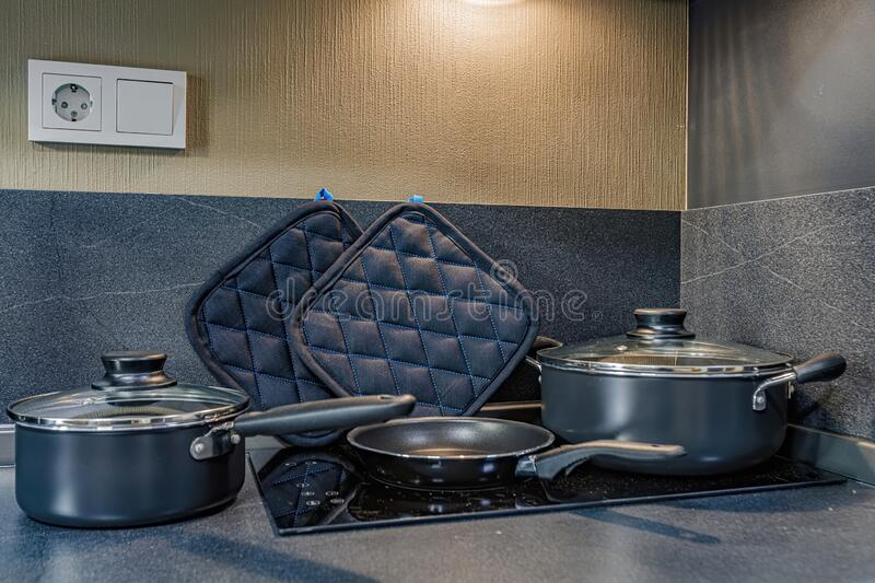 Pan on stove with stands on table closeup royalty free stock photos