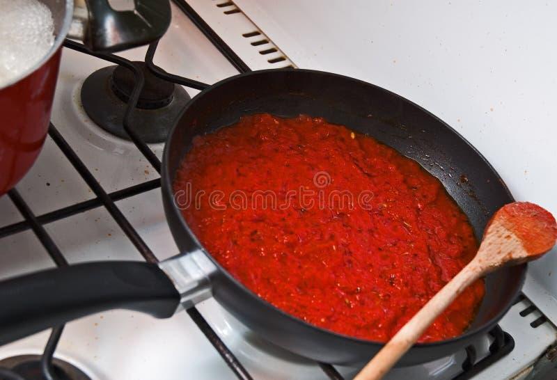 Pan with tomato sauce stock photos