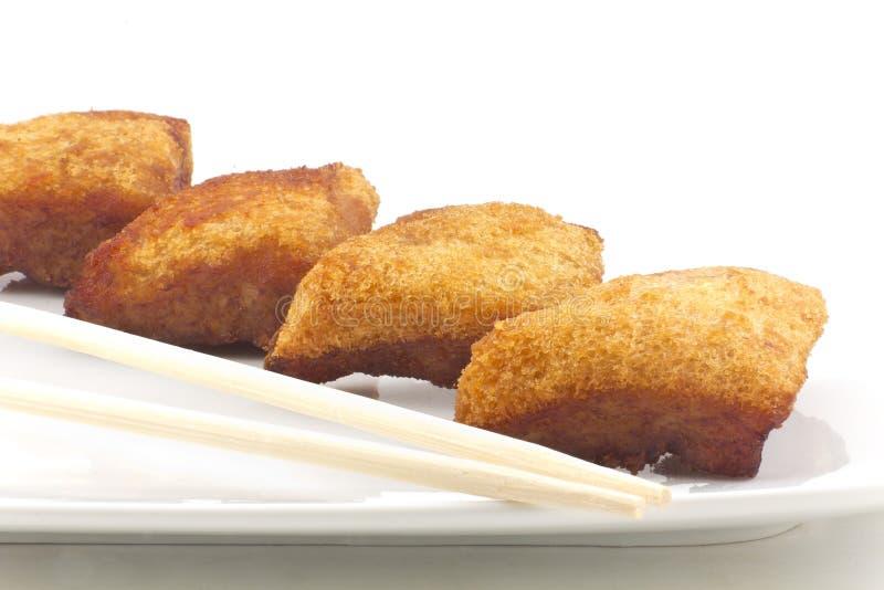 Pan tostado chino con el camarón picadito foto de archivo