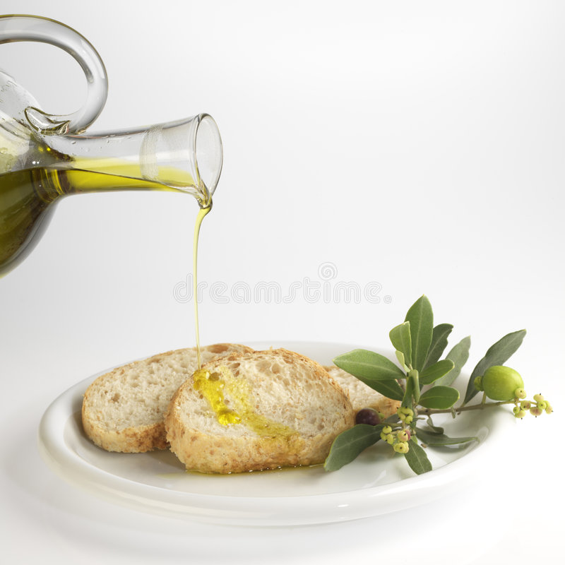 Pan y aceite de oliva fotos de archivo libres de regalías