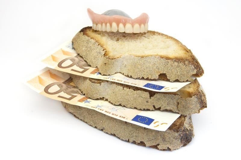 Pan y dinero fotografía de archivo