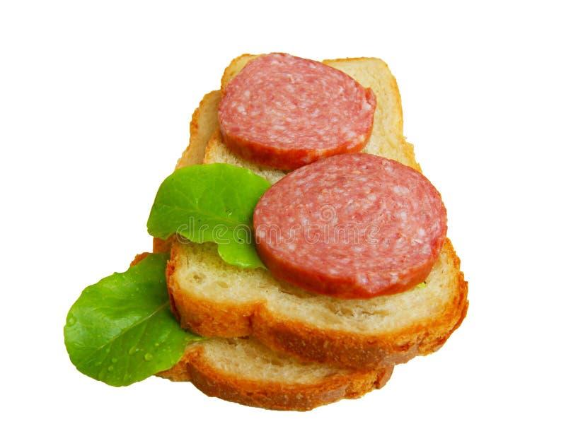 Pan y salchicha en blanco imagen de archivo