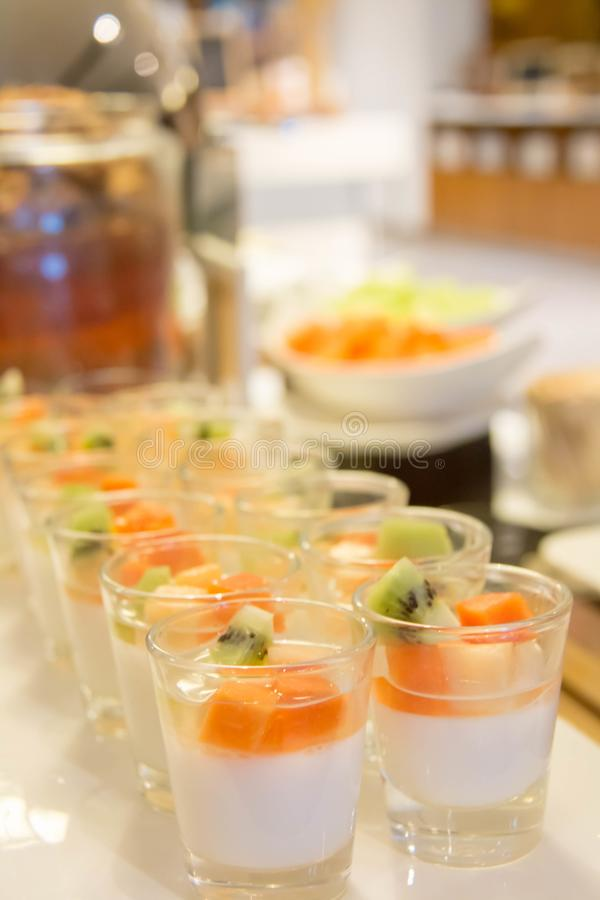 Panacotta with mixed fresh fruit in glass stock photos