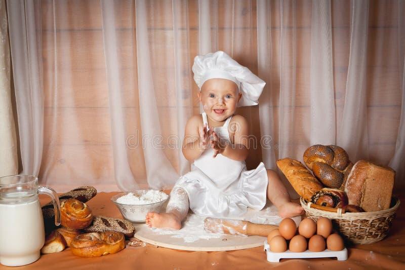 Panadero feliz del bebé fotografía de archivo