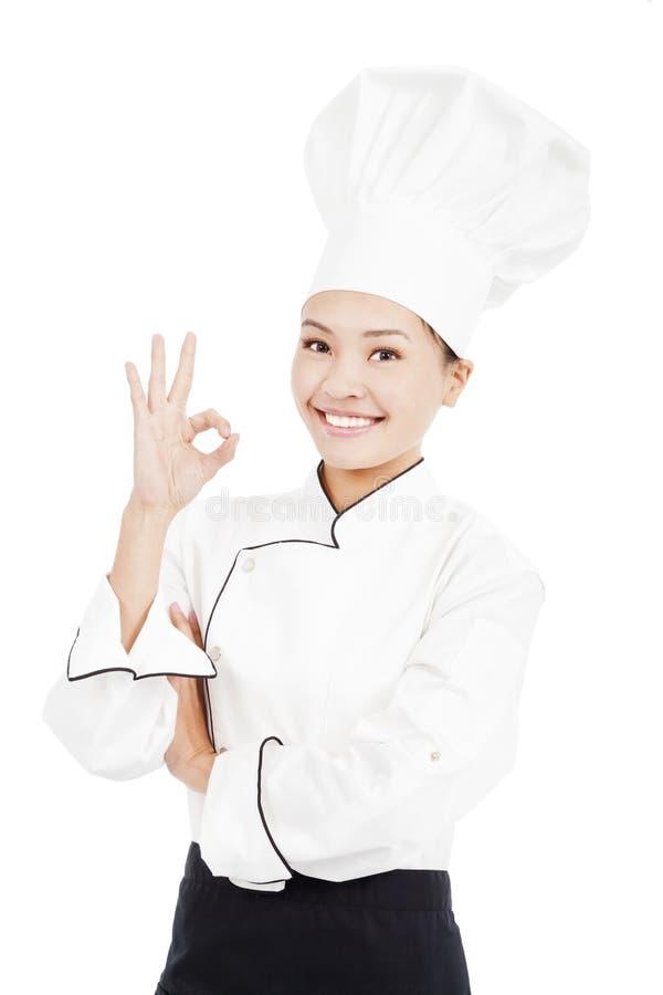 Panadero o cocinero del cocinero que muestra la muestra aceptable de la mano para la perfección imágenes de archivo libres de regalías