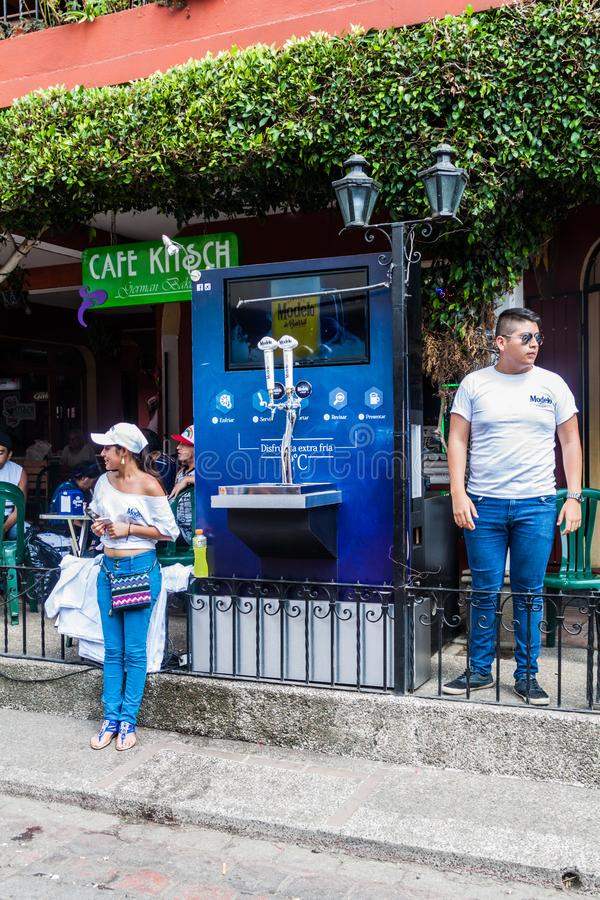 PANAJACHEL, GUATEMALA - MARCH 25, 2016: Modelo beer machine in Panajachel village, Guatemal. PANAJACHEL, GUATEMALA - MARCH 25, 2016: Modelo beer machine in stock images