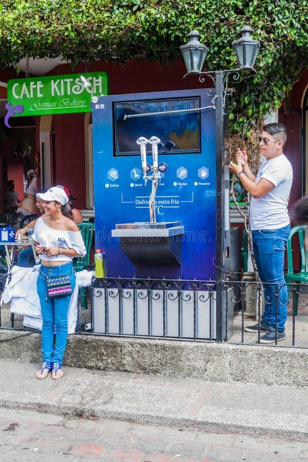 PANAJACHEL, GUATEMALA - MARCH 25, 2016: Modelo beer machine in Panajachel village, Guatemal. PANAJACHEL, GUATEMALA - MARCH 25, 2016: Modelo beer machine in stock photo