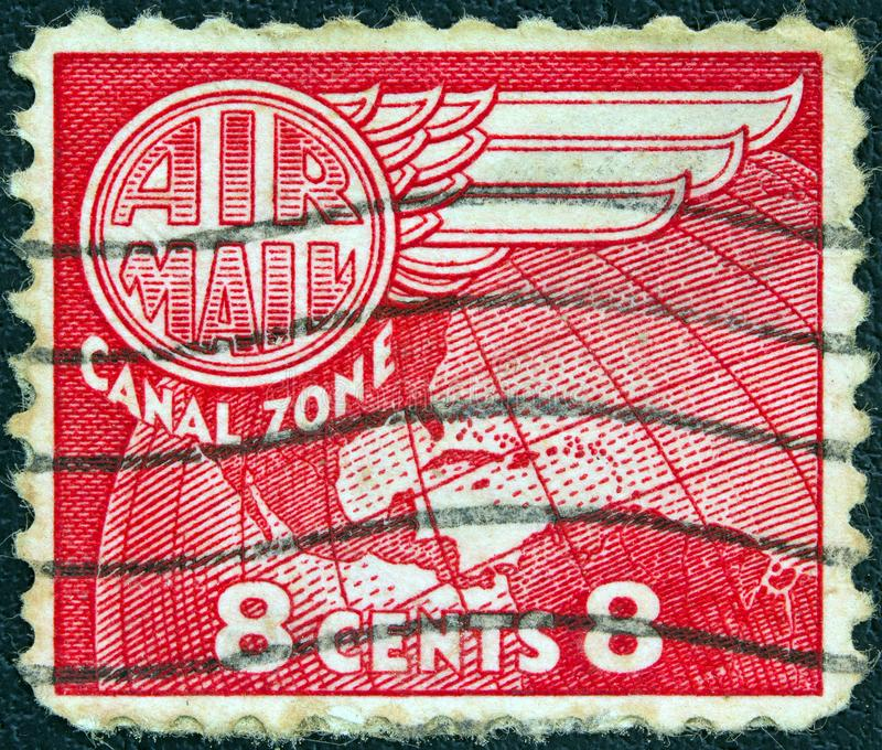 PANAMA CANAL ZONE- CIRCA 1951: A stamp printed in Panama Canal Zone shows a map of central America, circa 1951. royalty free stock photo