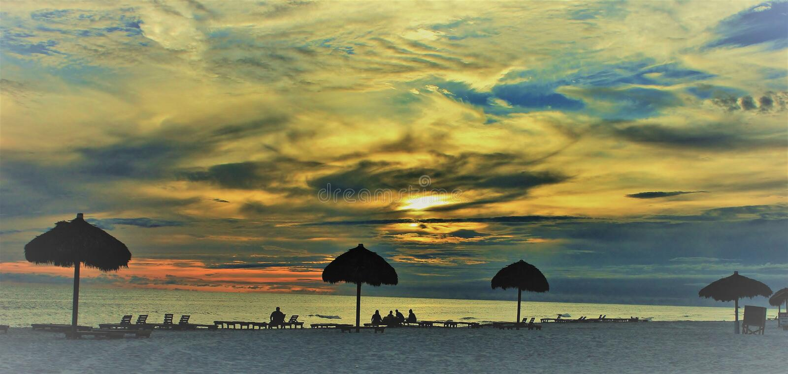 Panama City Beach Gulf of Mexico Palm umbrellas near sunset picturesque Deer stock photography