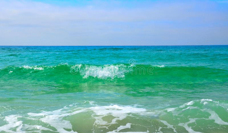 Panama City, FL, Gulf of Mexico blue green waters. Panama City, FL, USA, Gulf of Mexico white sands with blue green water and waves royalty free stock images