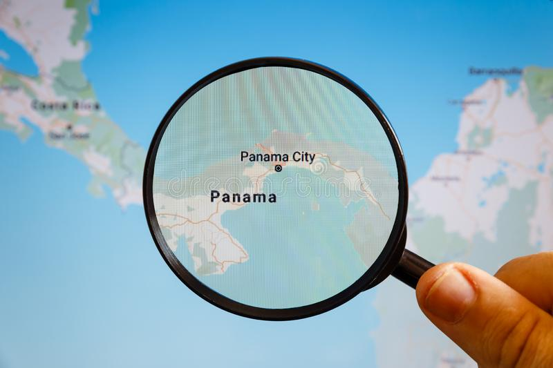 Panama City, Panama. Political map. The city on the monitor screen through a magnifying glass in hand royalty free stock image