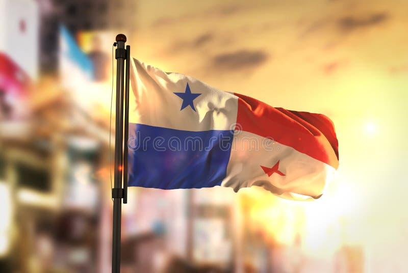 Panama Flag Against City Blurred Background At Sunrise Backlight. Sky stock photography