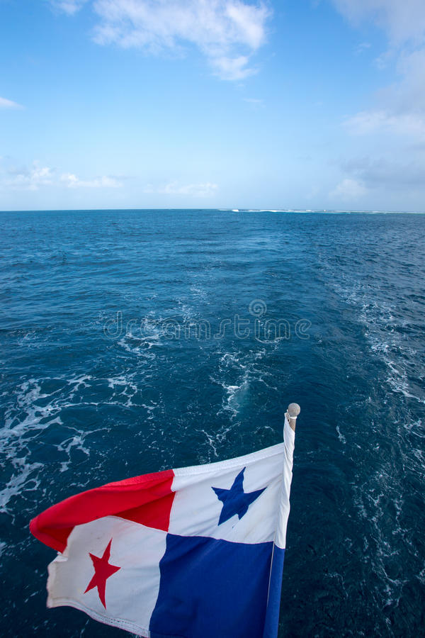 The Panama Flag waving with the horizon and the sea royalty free stock photo