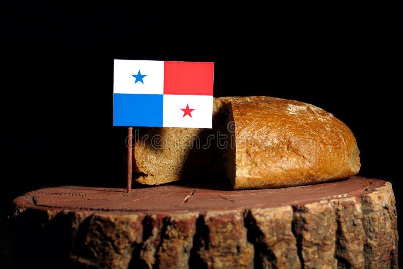 Panama-Flagge auf einem Stumpf mit Brot lizenzfreie stockfotos