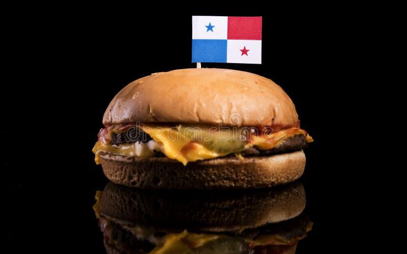 Panama-Flagge auf Hamburger auf Schwarzem stockbilder