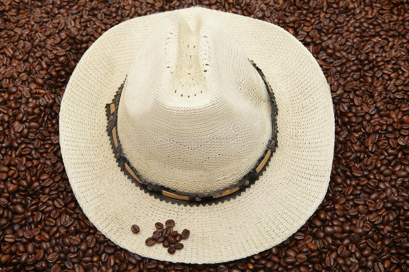 Panama hat on coffee beans stock photos