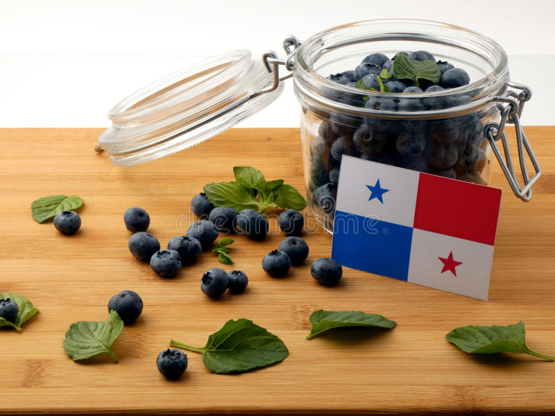 Panamanian flag on a wooden plank with blueberries on w royalty free stock photography