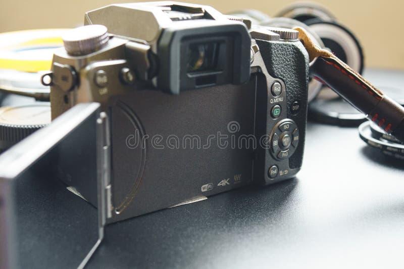 PANASONIC LUMIX G7. BISHEK, KYRGYZ REPUBLIC - APRIL 24,2018: Photo of PANASONIC LUMIX G7 mirrorless camera with digital display from behind stock photography