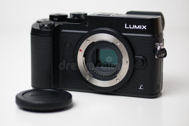 Panasonic Lumix GX8 Micro Four Thirds camera with image sensor exposed. Panasonic Lumix GX8 Micro Four Thirds camera with image sensor exposed on a white royalty free stock images