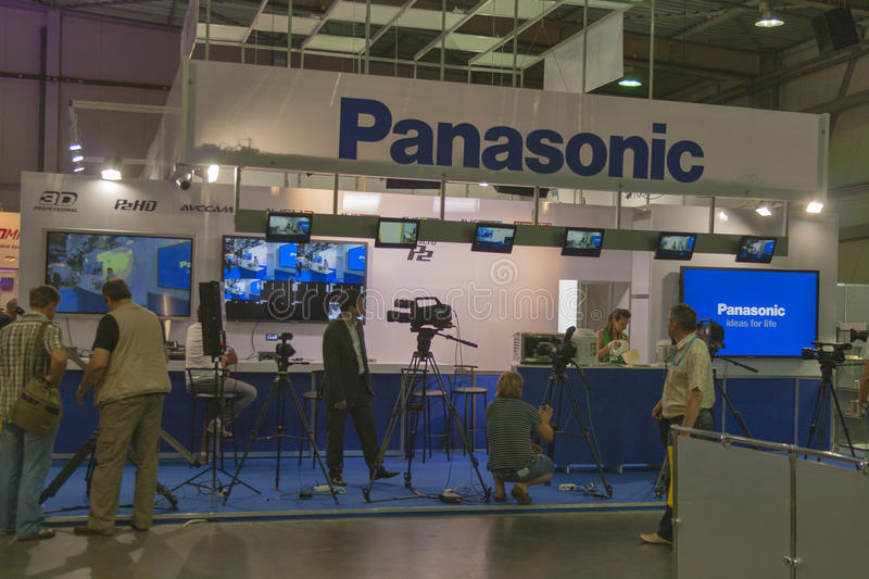 Panasonic TV equipment booth. Visitors visit Panasonic TV equipment booth at Kyiv International TV and Radio Fair 2013. It is the main business forum for royalty free stock photos