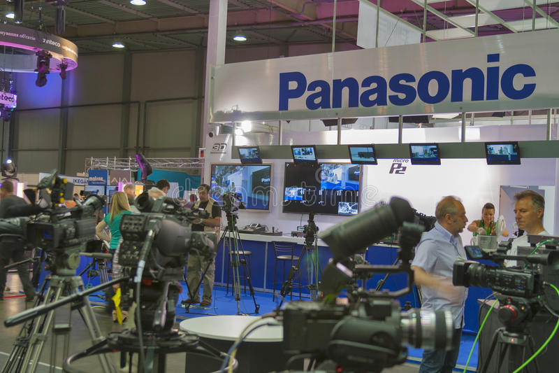 Panasonic TV equipment booth. Visitors visit Panasonic TV equipment booth at Kyiv International TV and Radio Fair 2013. It is the main business forum for stock image