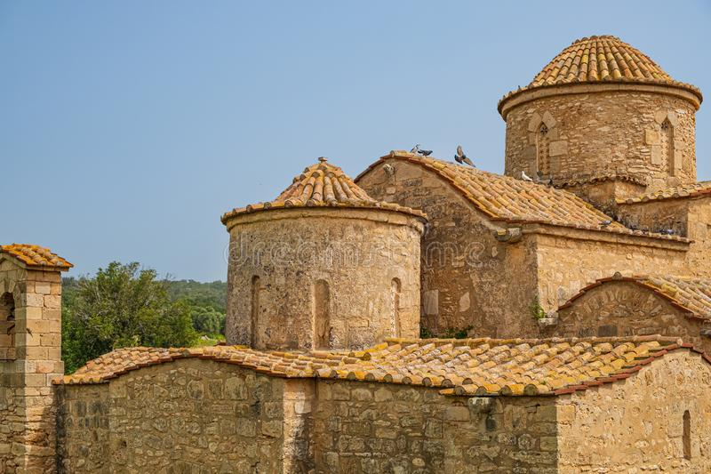 Panayia Kanakaria Church in Lythrangomi, Cyprus with pigeons flying off its roof stock photography