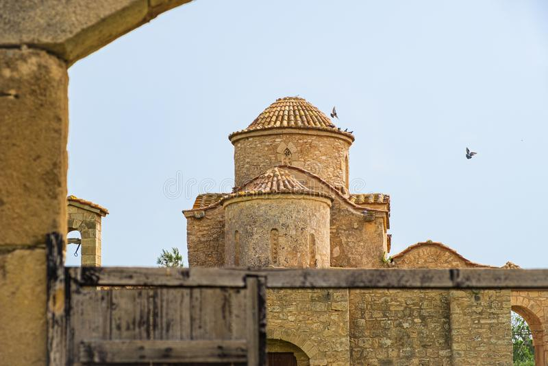 Panayia Kanakaria 6th century Byzantine Monastery Church in Lythrangomi, Cyprus with pigeons flying off its dome stock photo