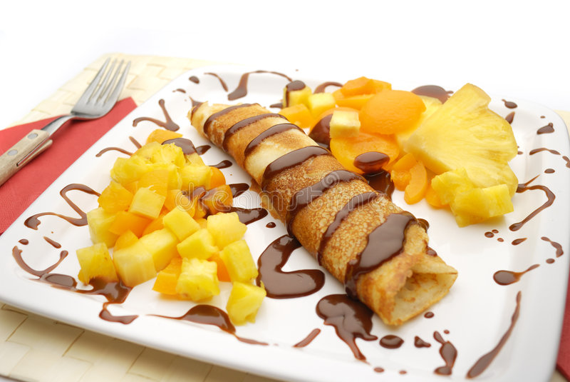 Pancake. The pancake dessert with chocolate royalty free stock images