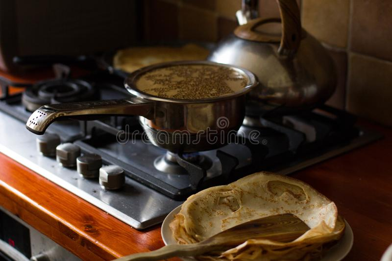 Pancake baked in a frying pan, close-up royalty free stock images