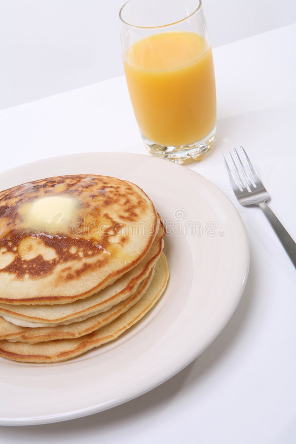 Pancake Breakfast. A delicious pancake breakfast on a white background stock image