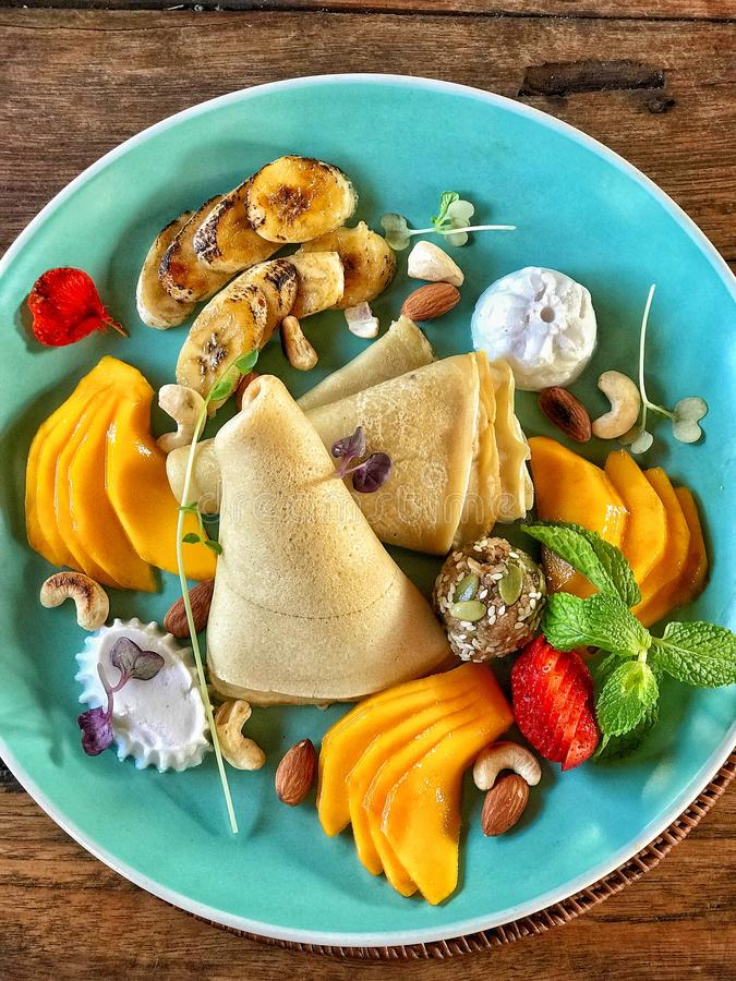 Pancake and fruit at breakfast stock photos
