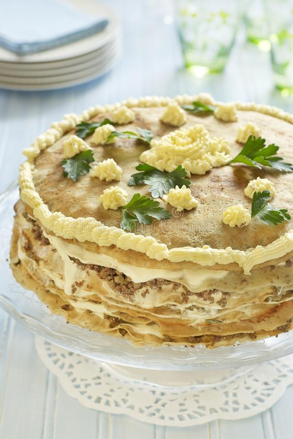 Pancake cake with liver, sour cream and parsley stock photos