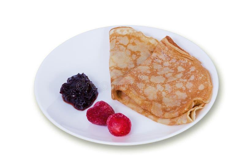 Pancake casalinghi con inceppamento e le bacche fotografie stock libere da diritti
