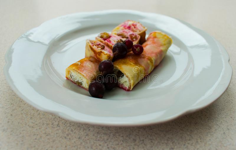 Pancake with cream cheese and berries stock images