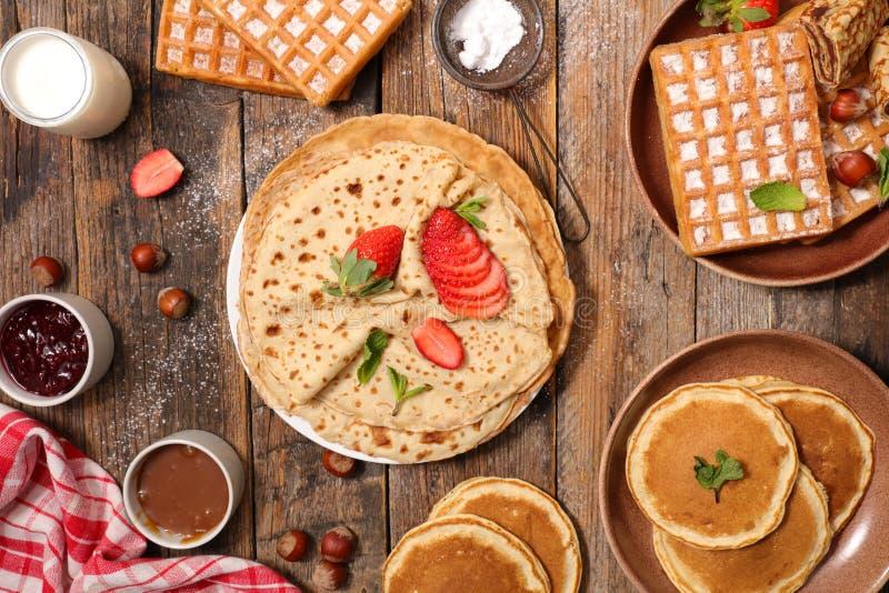 Pancake, crepe and waffles. On wood royalty free stock photo