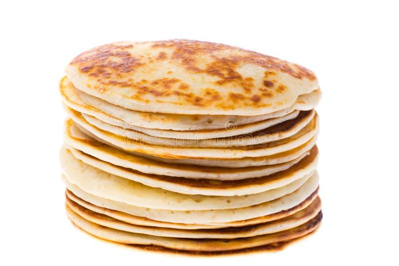 Pancake fertili e saporiti isolati su bianco immagini stock