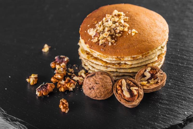 Pancake with fresh walnuts royalty free stock photos