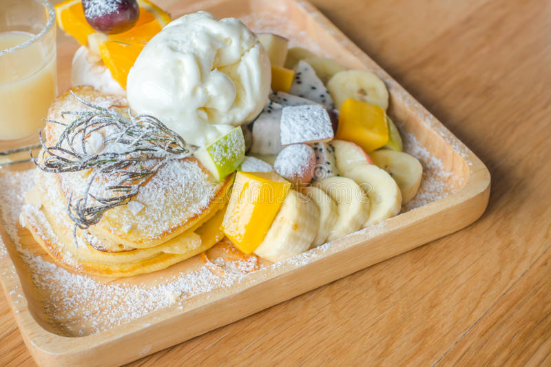Pancake and fruit with ice cream on table . Pancake and fruit with ice cream on table stock photography