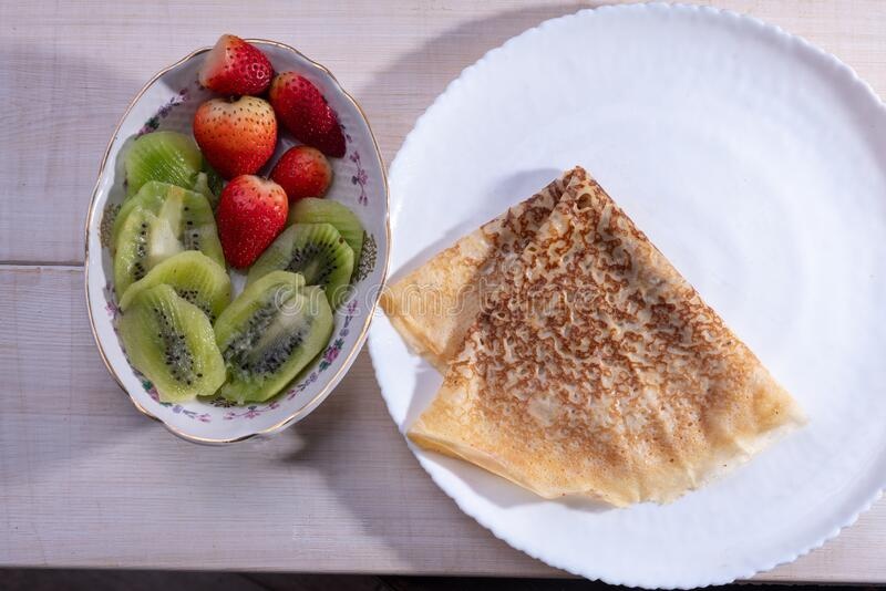 Pancake  and  fruits for Russian holiday   -Maslenitsa stock image
