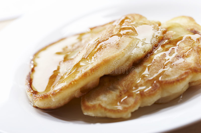 Pancake with honey stock images